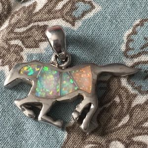 Opal and sterling silver. horse charm. So unique!